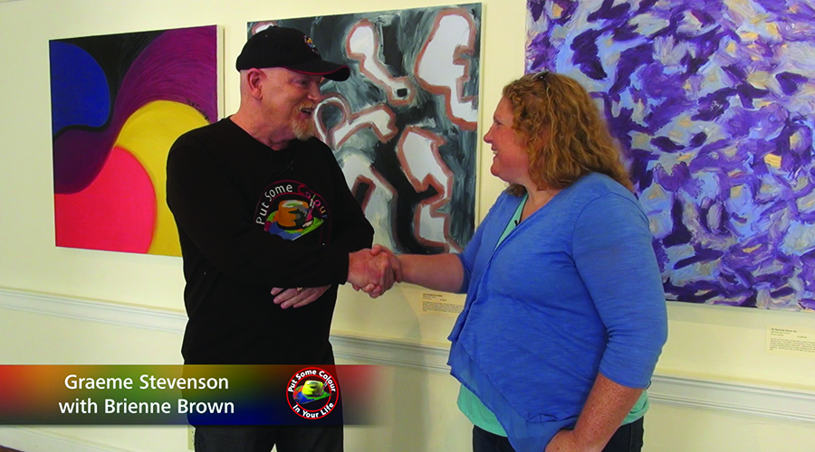 Brienne Brown and Graeme Stevenson shake hands on the set of Colour In Your Life TV Show