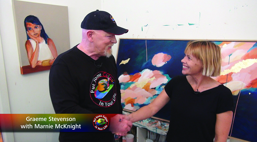 Marnie McKnight and Graeme Stevenson shake hands on the set of Colour In Your LIfe