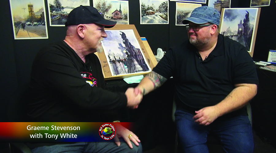 Tony White and Graeme Stevenson shake hands on the set of Colour In Your Life