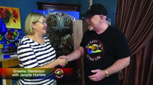 Janette Humble and Graeme Stevenson shake hands on the set of Colour In Your Life
