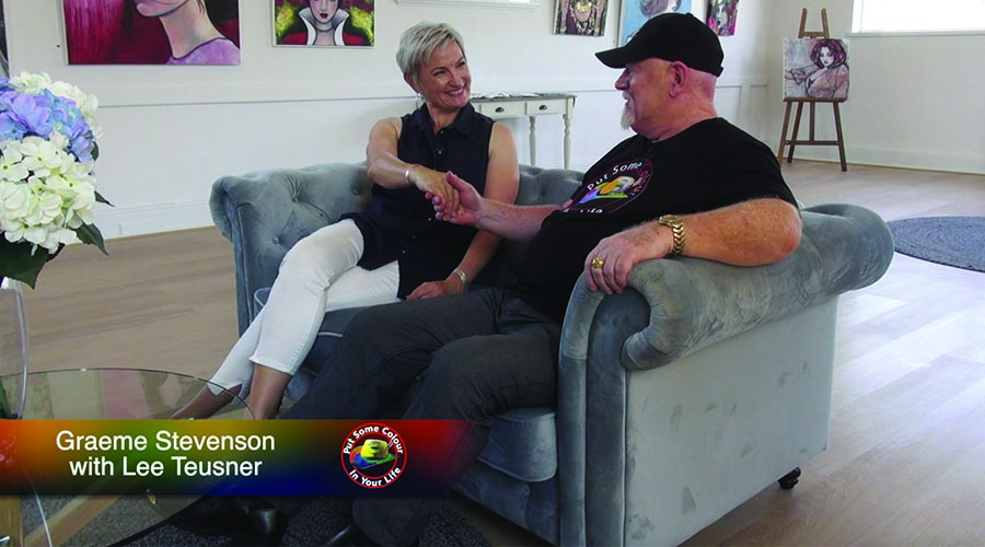 Lee Teusner and Graeme Stevenson shake hands on the set of Colour In Your Life
