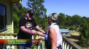 Miranda Free and Graeme Stevenson shake hands on the set of Colour In Your Life TV Show